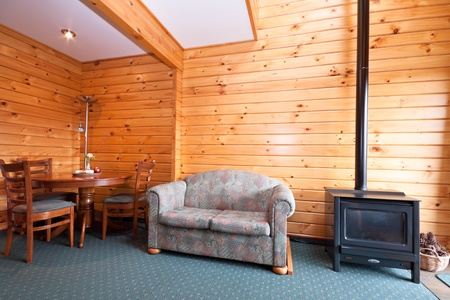 fox glacier: Lodge apartment interior with fireplace. Fox Glacier Lodge, Fox Glacier, West Coast, South Island, New Zealand. Stock Photo