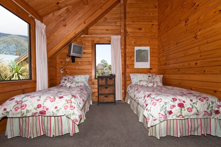 fox glacier: Two beds in wooden lodge bedroom. Fox Glacier Lodge, Fox Glacier, West Coast, South Island, New Zealand.
