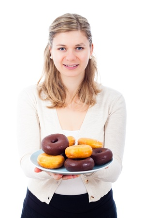 Happy young beautiful woman holding plate with delicious sweet homemade donuts, isolated on white background. photo