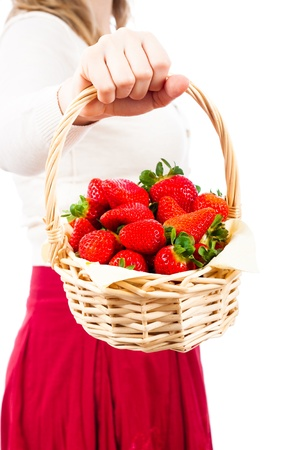 Detail of woman holding basket with delicious juicy fresh strawberries, isolated on white background. photo