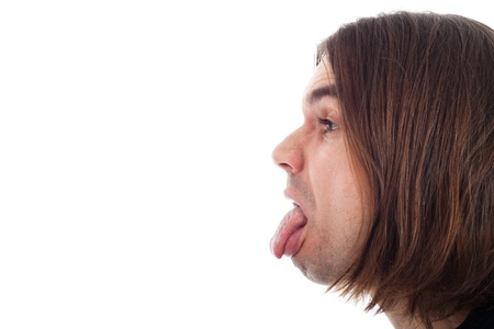 long haired: Profile of young long haired man face sticking out tongue, isolated on white background with large copy space.