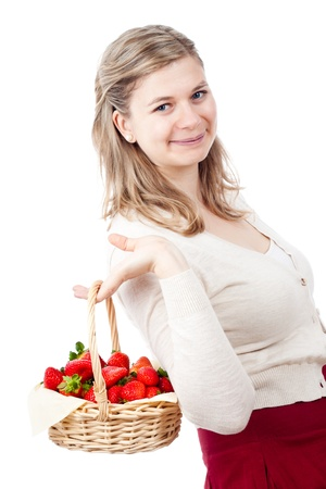 Beautiful young cute happy woman holding basket with fresh strawberries, isolated on white background. photo