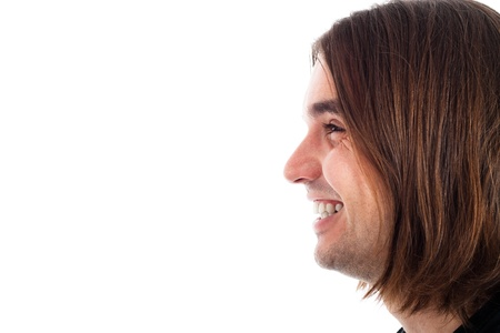 Profile of young long haired happy man face laughing, isolated on white background with large copy space. Stock Photo