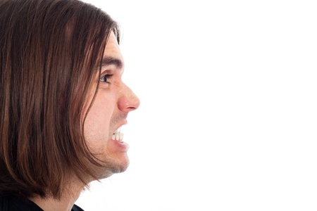 Profile of young long haired man face shouting, isolated on white background with large copy space. Stock Photo - 13106378