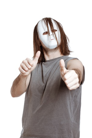 Horror scary masked successful man gesturing thumbs up, isolated on white background. Stock Photo - 13106640