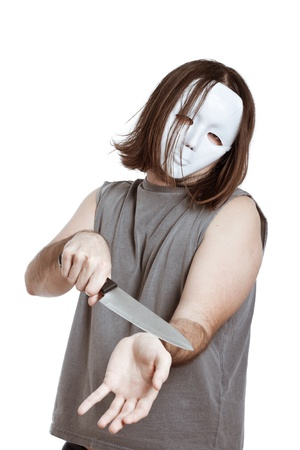 attempting: Scary masked psycho man attempting suicide, isolated on white background. Stock Photo