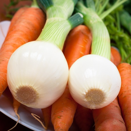 organics: Close up of fresh spring onions and carrots.