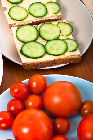 Healthy vegetarian sandwiches with cheese, cucumber and tomatoes. photo