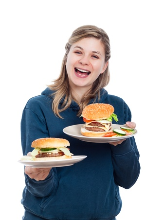 Young happy woman holding fresh homemade hamburgers, isolated on white background. Stock Photo - 13106639