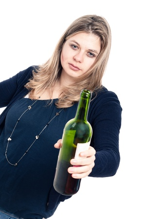 tipsy: Portrait of young drunk woman with bottle of wine, isolated on white background. Stock Photo