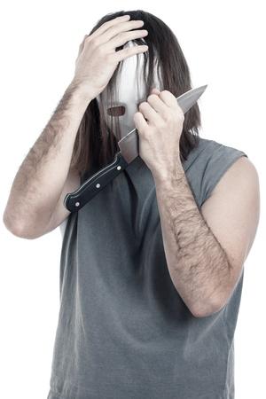 slayer: Depressed scary psycho masked man with knife, isolated on white background. Stock Photo
