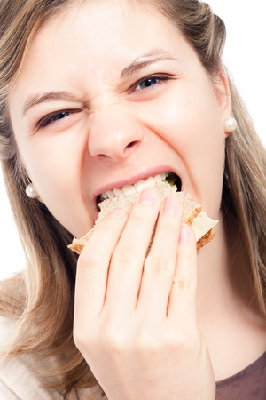 Close up of hungry woman eating sandwich. photo