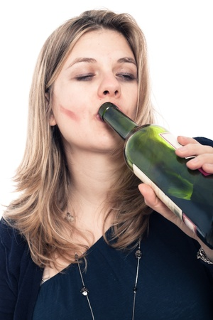 Portrait of drunk woman drinking bottle of wine, isolated on white background. photo