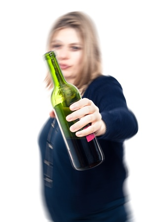 intoxicated: Drunk woman with bottle of wine, with motion blur effect and isolated over white background. Stock Photo
