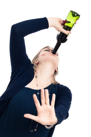 Portrait of young drunk woman drinking wine and gesturing stop, isolated on white background. photo