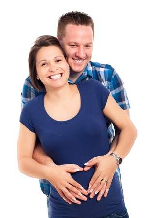 Portrait of happy pregnant woman with her husband, isolated on white background. photo