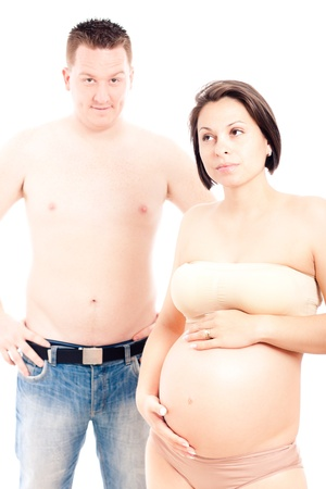 Creative fine art portrait of young beautiful pregnant woman and her husband, isolated on white background. Stock Photo - 13222659