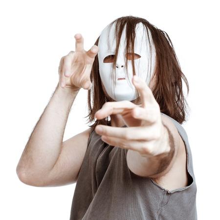 slayer: Insane scary masked man gesturing, isolated on white background. Stock Photo