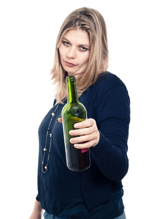 intoxicated: Frustrated drunk woman holding bottle of wine, isolated on white background. Stock Photo