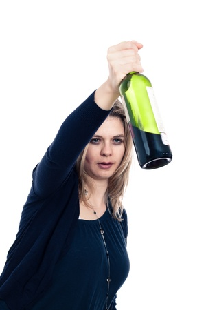 intoxicated: Drunk woman holding bottle of wine, isolated on white background.