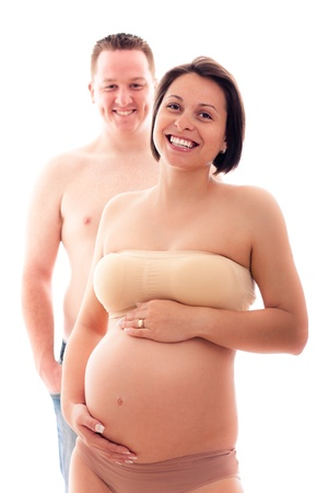 Portrait of beautiful pregnant woman and her husband laughing, isolated on white background Stock Photo - 13338107