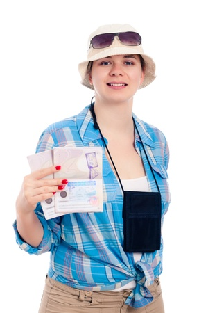 Happy traveller woman showing passport, isolated on white background  Stock Photo - 13338119