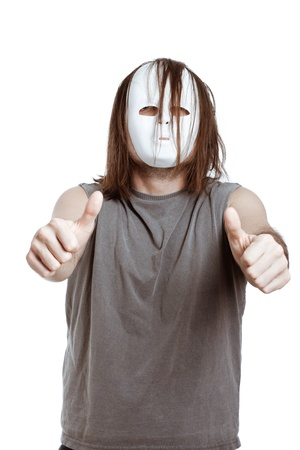 Horror scary masked man gesturing thumbs up, isolated on white background. Stock Photo - 13584757
