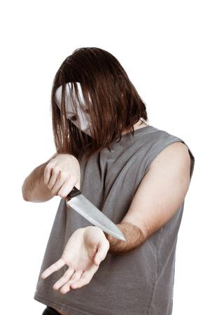psychopathe: Effrayant l'homme masqu� d'horreur avec le suicide couteau tente, isol� sur fond blanc.