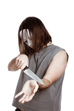 Scary masked horror man with knife attempting suicide, isolated on white background. photo