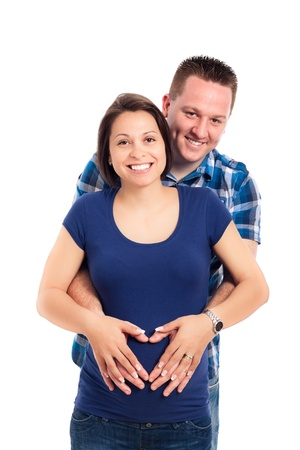 Happy pregnant couple smiling, isolated on white background. Stock Photo - 13584753