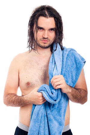 Young longhaired unshaved confident man after bath with towel, isolated on white background. photo