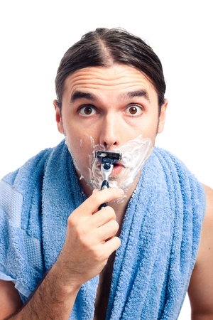 longhaired: Young shocked man shaving after bath, isolated on white background.