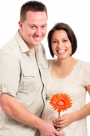 Beautiful young happy smiling pregnant couple with flower, isolated on white background. Stock Photo - 13712165