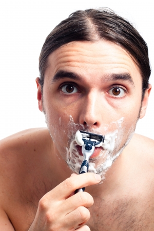 longhaired: Young funny man shaving after bath, isolated on white background. Stock Photo