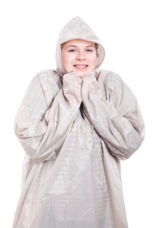 waterproof cape: Happy young smiling woman in raincoat, isolated on white background.