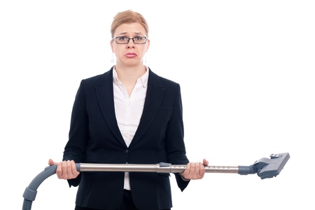 discomfiture: Unhappy desperate businesswoman with vacuum cleaner, isolated on white background.