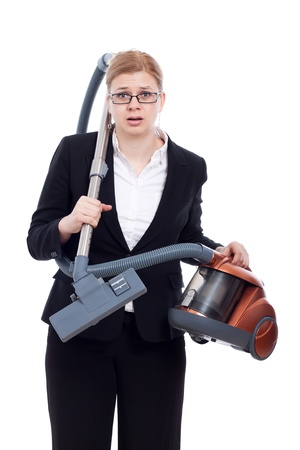 Unhappy shocked businesswoman with vacuum cleaner, isolated on white background. photo