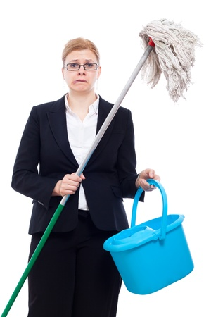 discomfiture: Unhappy desperate businesswoman with bucket and mop, isolated on white background. Stock Photo