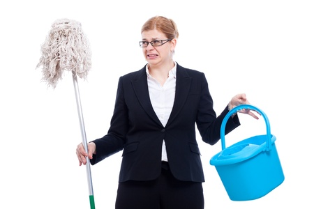 discomfiture: Unhappy disgusted businesswoman with bucket and mop, isolated on white background. Stock Photo