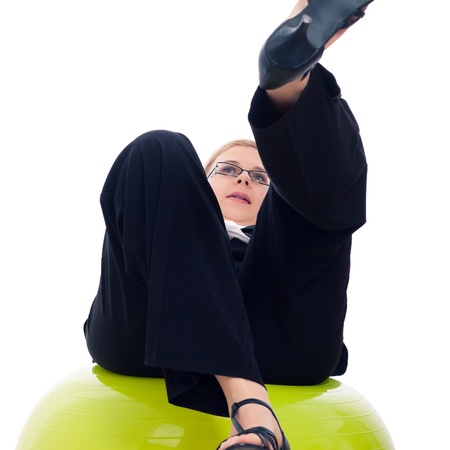 Businesswoman falling down from green exercise ball, isolated on white background. photo
