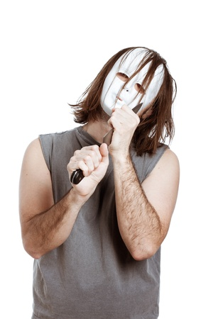 Scary bizarre masked man holding knife, isolated on white background. photo