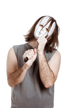 Scary bizarre masked man holding knife, isolated on white background. Stock Photo - 14189980