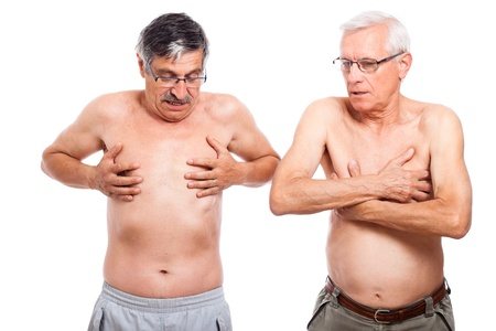 Two naked senior men exploring their body, isolated on white background.