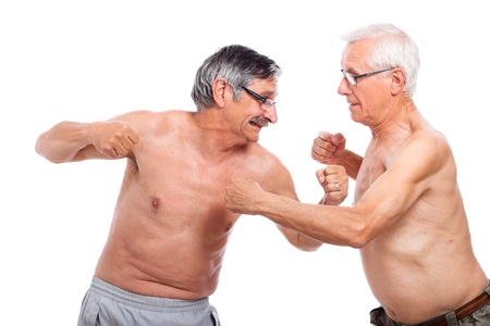 Two naked senior men fighting, isolated on white background. Stock Photo - 14189947