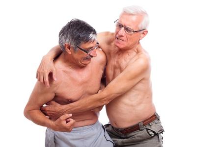 Two naked seniors fighting, isolated on white background. Stock Photo - 14189946
