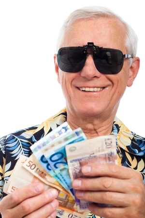 holidays vacancy: Happy rich elderly man with money, isolated on white background.