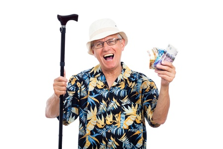 Excited happy elderly man holding money and walking stick, isolated on white background. photo