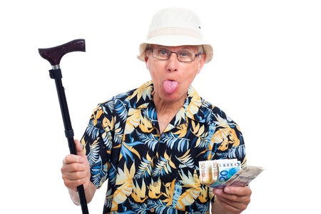 holidays vacancy: Elderly man making funny faces, holding money and walking stick, isolated on white background.