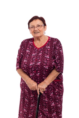 Portrait of happy smiling elderly woman with walking stick, isolated on white background. Stockfoto