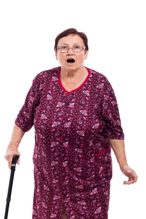 Portrait of surprised elderly woman with walking stick, isolated on white background.